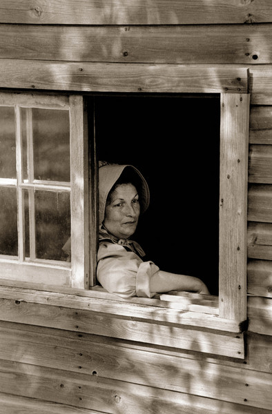 An interpreter peers wistfully out the sauna window at the Ketola (Finnish) farm.  She may be wondering whether she should have emigrated to the New World where life is so hard.