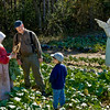 Visitors admire the garden harvest at the 1897 Rankinen (Finnish) farm during the Autumn on the Farms special event.