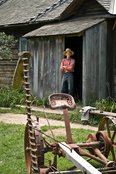 A farmer admires his mower from the doorway of the Ketola farm.