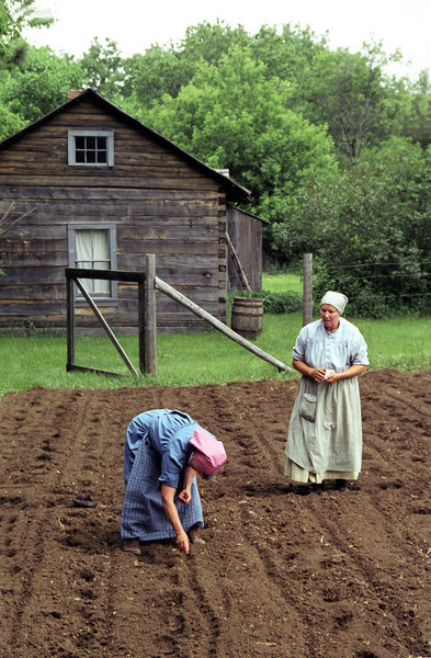 Gardeners plant the garden at the 1915 Ketola farm.