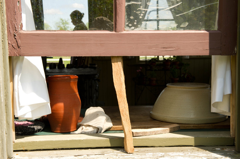 Interior of Mary Hafford's house in Crossroads Village as seen through a window.