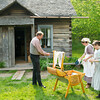 Interpreters at the 1915 Ketola Finnish dairy farm wring laundry by hand..