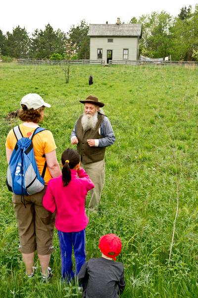 """Prairie Bob"" greets visitors as they enter Crossroads Village and tells vistors about the native prairies found in Wisconsin in the 19th century."