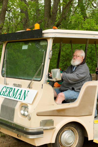 A tram driver takes visitors to the German area of Old World Wisconsin.