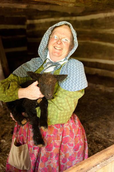 An interpreter shows off a new lamb at the Norwegian Kvaale farm.