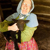 An interpreter shows off a new lamb at the Norwegian Kvaale farm.
