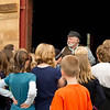 Schoolchildren at the Groteluschen blacksmith shop in Crossroads Village learn about the role blacksmiths played in the 19th century.