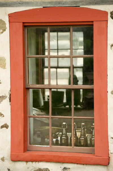 Looking through windows in the Schottler farm summer kitchen.