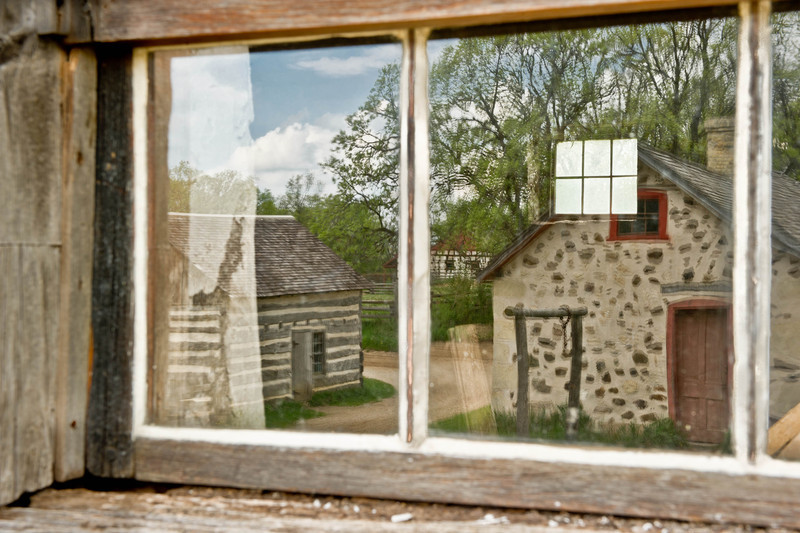 Reflection in a window of the pig barn at the 1875 Schottler farm in the German area.