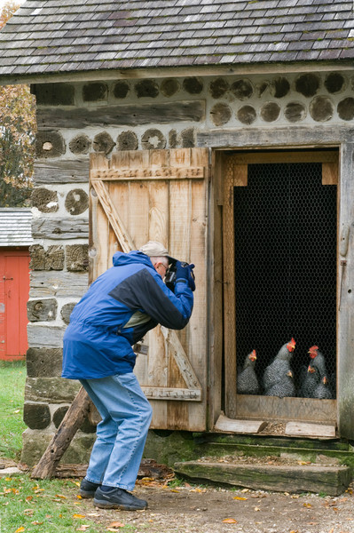Self portrait of Loyd Heath photographing chickens at the 1900 Kruza (Polish) house.  Chickens were housed in one end of the house while the family lived in the other end.