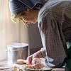 An intrerpreter makes a pie at the Schulz farmhouse.