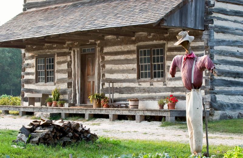 A scarecrow guards the 1875 Schottler (German) farmhouse.
