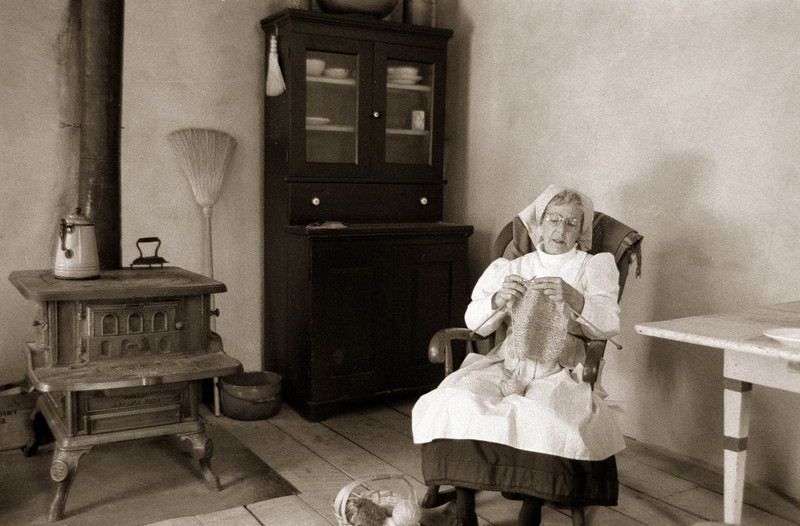 An interpreter knits while awaiting vistors to the 1900 Kruza (Polish) house.