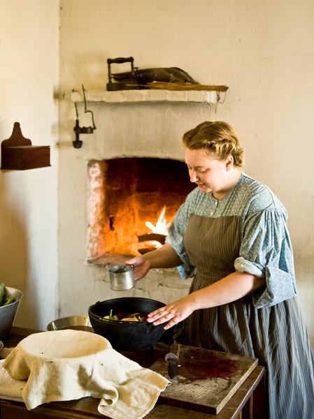 An interpreter prepares dinner in the Schulz farmhouse kitchen.