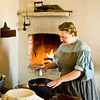 An interpreter prepares dinner in the Schulz farmhouse kitchen.