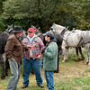 Horse owners from the Jefferson County Draft Horse Association at the annual Autumn on the Farms event at Old World discuss plans for working the fields while waiting for dinner to be served at the Koepsell farm.