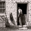 An interpreter is seen entering the pig barn at the 1875 Schottler farm.