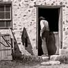 An interpreter is seen entering the pig barn at the 1875 Schottler farm.
