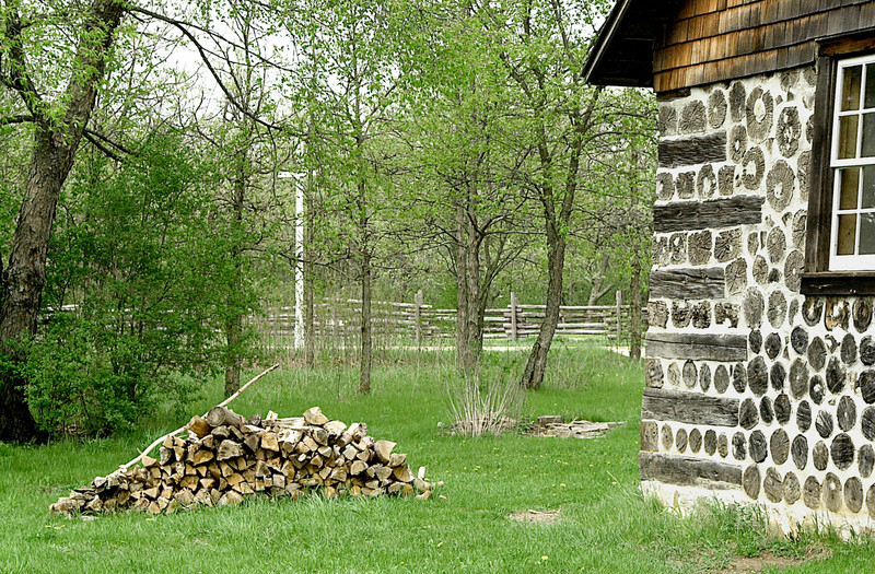 "The 1884 Kruza (Polish) house in the German area.  Note the ""stovewood"" construction of the walls.  This type of construction was labor intensive but required only one person and was sometimes used because of the plentiful supply of cordwood."