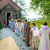 Campers from the Laura Ingalls Wilder summer camp line up before entering the 1906 Raspberry one room schoolhouse in the Norwegian area.