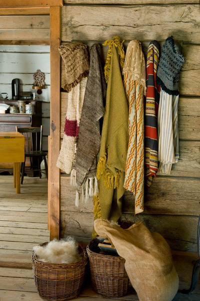 Wool clothing hanging in the farmhouse at the Kvaale sheep farm.