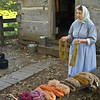 An interpreter talks to vistors about the yarn she has been dyeing at the Kvaale farm.