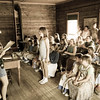 A contestant in a spelling bee for Laura Ingalls Wilder summer campers tries to think of how to spell a word while her fellow campers look on.  The spelling bee was held in the 1906 one room Raspberry school.