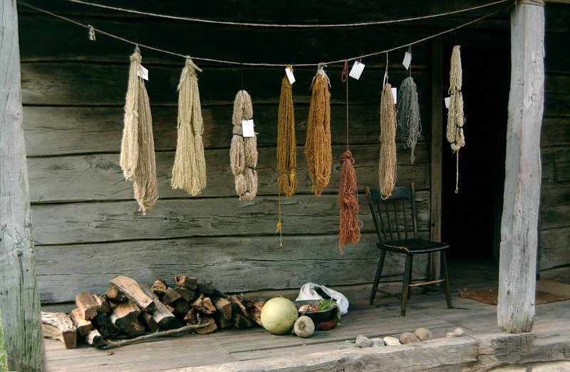 Dyed yarn is hung up to dry on the front porch of the 1865 Kvaale farmhouse.