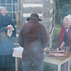 Interpreters at the Fossebrekke farm cook a rabbit and offer samples to visitors at the Autumn on the Farms special event in October.