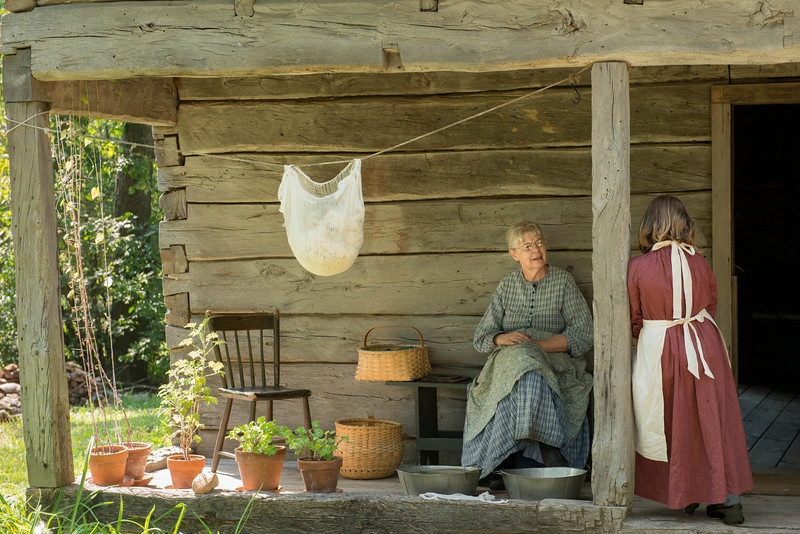 Interpreters chat on the porch of the Kvalle farm.