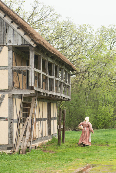 An interpreter passes by a barn at the Schulz farm.