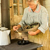 An interpreter makes ebelskivers in the kitchen of the Pedersen Danish farmhouse.
