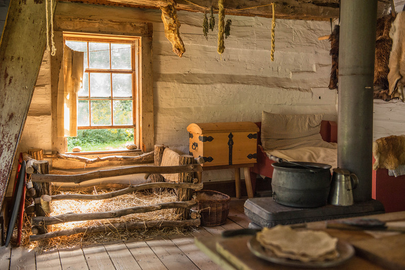 Interior of Fossebrekke cabin.  Note small pig pen for keeping pig safe and warm in cold weather.