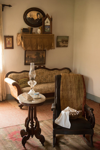 Parlor of the Koepsell farmhouse.  Note portrait of the Koepsells on the far wall.
