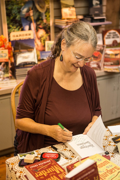 "Kathleen Ernst in the Old World Wisconsin gift shop where she signs copies of her books including ""Old World Murder."""