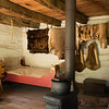 Interior of Fossebrekke cabin.  Note hanging skins.  Knud Fossebrekke was a trapper as well as a farmer.