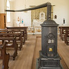 St. Peter's church in Crossroads Village.  Note the long stovepipe used to distribute heat to the entire room.