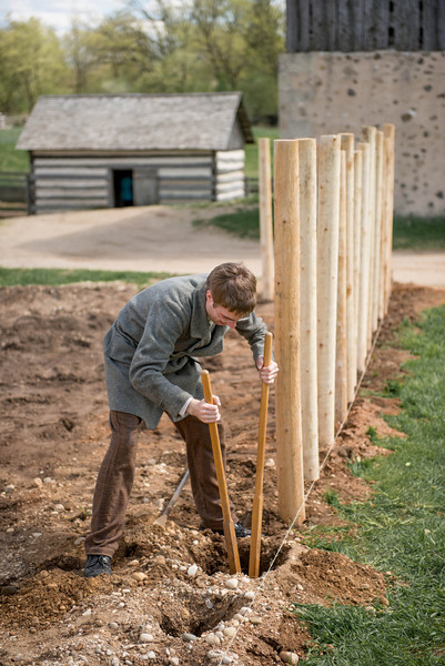 Digging post holes for a new twig fence for the garden at the Schottler farm.