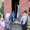 Children line up to be let into the one room Raspberry schoolhouse at the start of the day.