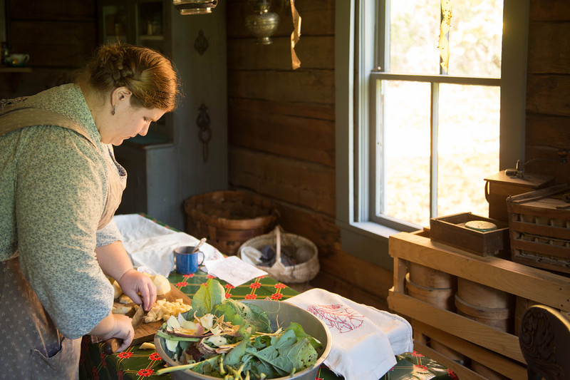 Making salad in the kitchen of Ketola Finnish farmhouse.