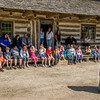 "Students on a field trip learn about life in ""the old country"" at the entrance to the Schottler farmhouse in the German area."
