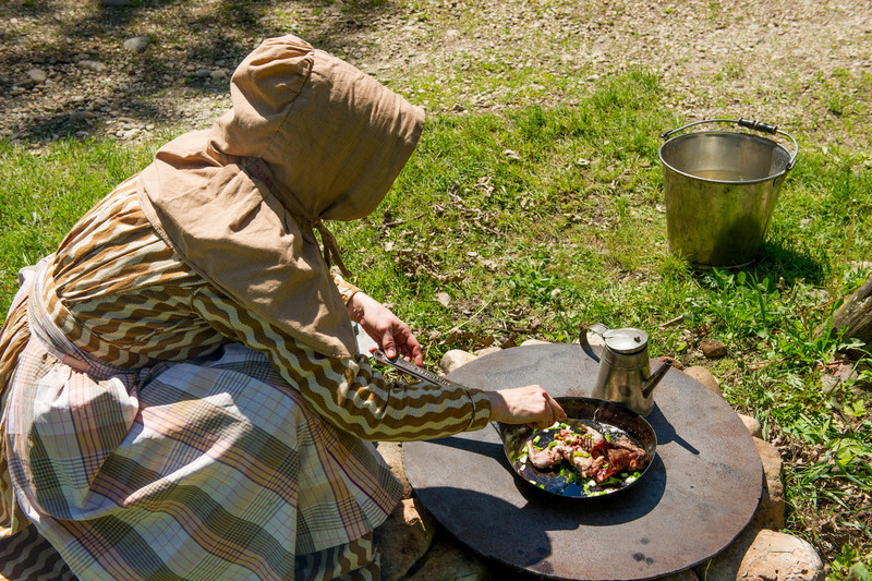 An interpreter prepares dinner at the Fossebrekke farm in the Norwegian area of Old World.