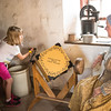 Learning how to churn butter at the Schottler farm.