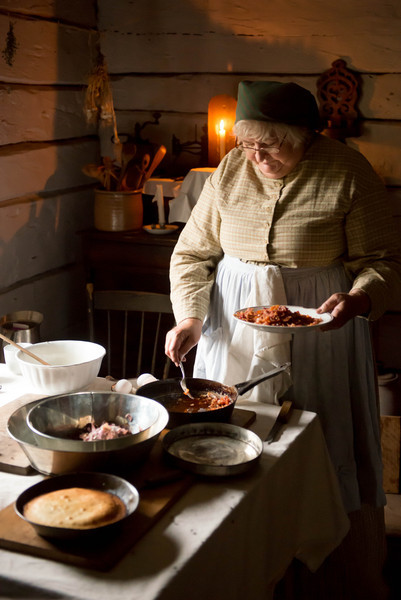 Serving food in the Kvaale farmhouse in the Norwegian area.