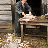 Cleaning and preparing a chicken at the Ketola farm in the Finnish area.
