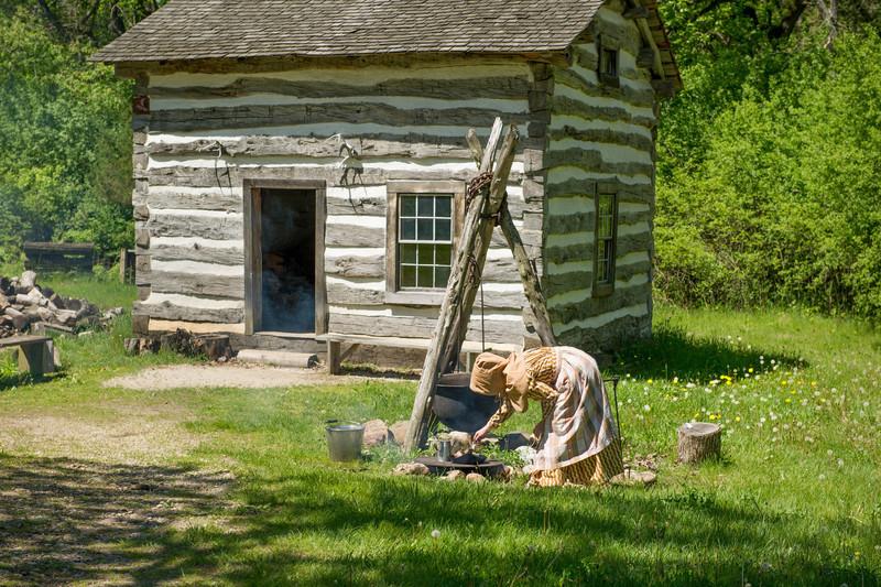 An interpreter prepares dinner at the Fossebrekke farm in the Norwegian area of Old World.