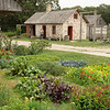 The garden, farmouse, and summer kitchen at the Schottler farm in the German area.