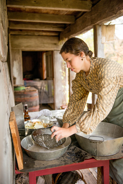 Washing dishes on the front porch of the Kvaale farmhouse.