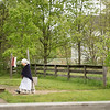 An interpreter heads towards Mary Hafford's house in Crossroads village.