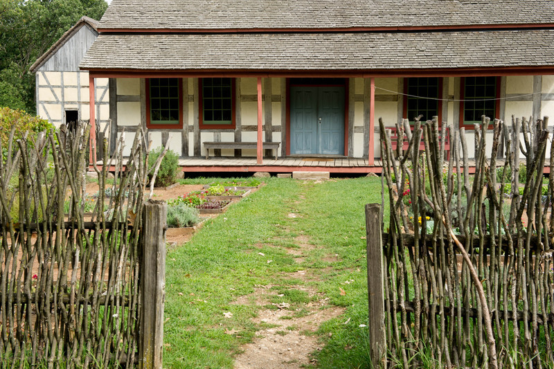 Front entrance to the Schultz farmhouse with a twig fence to keep animals out of the garden.